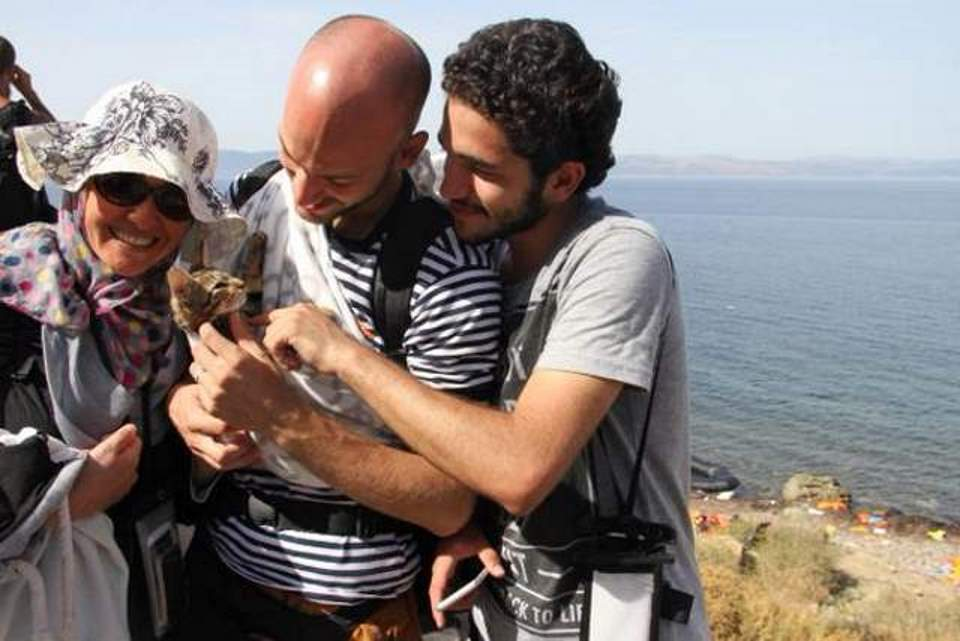 Syrian refugees with their cat